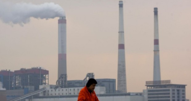 epa03538916 A docker works as smoke billows from a chimney at a power plant in Qingdao city, eastern China's Shandong province, 16 January 2013. Blind growth in China is the cause of the smog that has smothered Chinese cities including Beijing for a week, the government said 16 January in its first comment on the worsening air quality. Inefficient production methods and the weather were behind the thick, grey air, Vice Prime Minister Li Keqiang was quoted as saying by the state-owned China News Service. 'It warns us once again that we cannot continue the inefficient economic growth model,' he said. Years of rapid growth have vaulted Communist China into second place among the world's largest economies but often at the expense of the environment. The smog has limited visibility, cancelled flights, kept people indoors and sent them to hospitals with breathing, heart and circulation problems.  EPA/WU HONG